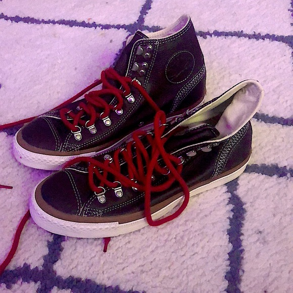 brown high top leather converse with red laces